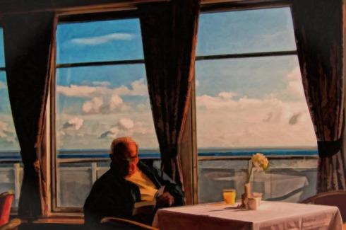 man-reading-at-sea